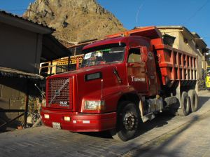 Highway traffic through World UNESCO Town of Ollantaytabmo Peru